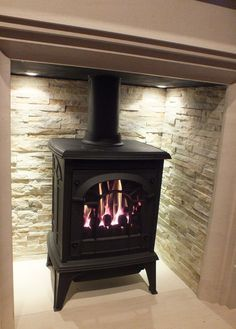 wood burner in fireplace modern Wood, Home Living Room, Slate Interior, Snug Room, Fireplace Design, Log Burner Living Room, Cosy Room, Front Rooms, Modern Fireplace