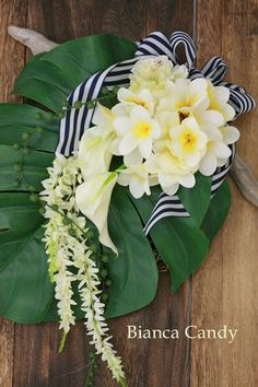 An exotic nautical flair bouquet. For a destination wedding, bring your own ribbon, use local flowers and plant or banana leafs! Imagine a string of exotic flowers down a palm frond! destination weddings with PJ
