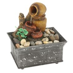 TRANQUILITY POTTERY FOUNTAIN Turn any space into a peaceful oasis with this portable tabletop fountain. You'll enjoy the soothing sound of cascading water as it falls from pot to pot, and the cordless design means you can set this water feature anywhere you need a little tranquility.  $15.99