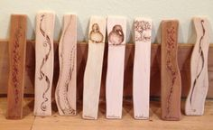 """Each bookmark is 6"""" long and about 1"""" wide.  I cut each on, prepare it and then do the burning. This is a small sample of what I have on my shelf and what I have sold.  On the back of each I indicate what wood I have used."""