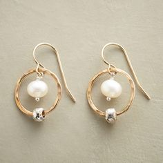 "LOVE'S ORBIT EARRINGS�--�Like stars orbiting the moon, sterling silver beads slide on hammered 14kt gold filled hoops encircling cultured freshwater pearls. Handmade in USA. Exclusive. 14kt gold filled French wires. 1-1/8""L."
