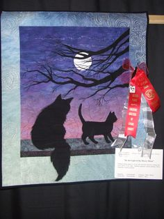 """By The Light of the Silvery Moon"" machine applique and machine quilting. Two awards in 2 shows. My original design."