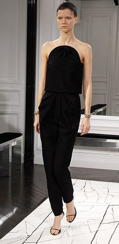Strapless  A definite example of the Raf-at-Dior effect. Ever since Simons arrived at the French house, he has worked strapless looks into his collections with verve and modernity. Last Friday, in Paris, he did it again with silk bustiers, either as the tops of dresses or as a separate top with a skirt. Alexander Wang's largely successful Balenciaga debut (above) featured a black bustier with cigarette trousers. Very Raf-at-Dior....