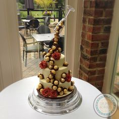 Antigravity Ferrero Rocher wedding cake with hand made sugar roses. Rich chocolate, light vanilla and boozy fruit cakes made up the tiers.