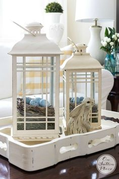 Decorating with Lanterns | Ideas and inspiration from On Sutton Place | Nests with eggs | Decorating with a set of lanterns is easy and versatile. They can be changed out seasonally, moved around, layered on a tray or lined up on a stairway. This is a great guide for adding this classic accessory to your decor!