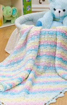 "Diamond Baby Blanket ~ free pdf pattern. RH Baby 3.5 oz (100g);278 yds (254m): 3 balls Lolli A, 1 ball Wading Pool B.Crochet Hook: H/8/5mm.   Blanket measures 30"" x 42"".  GAUGE: 12 sts = 4""; 8 rows = 4"".  from Red Heart (yarn suggested has been discontinued)"