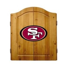 This NFL San Francisco 49ers Wooden Dartboard Cabinet Set is made of solid  pine and makes a great gift for the sports fan in your life. This  officially licensed dartboard comes with mounting hardware and six team  logo darts.   Great gift for sports fan Perfect for man cave or garage Made by Imperial International Solid pine wood dartboard cabinet All natural 18-inch bristle dart board Mounting instructions and hardware included Six steel darts with team logo on flights Includes chalk and…