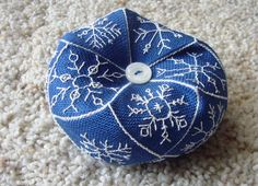 Snowflake Biscornu, stitched by Colorado Stitcher blogger, Mary.  This 15-sided biscornu seems very similar to @Lesley Bousbaine, tintocktap blogger's Snowflakes in the Snow 15-sided biscornu.