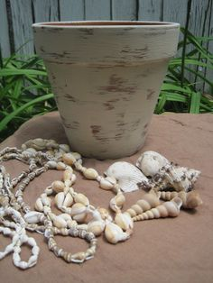 Opulent Cottage: Decorative Shell-Encrusted Flower Pot - for those jars full of seashells we have...