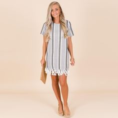 """9259575539c The Blue Door Boutique ™ on Instagram  """"Easy linen shift dress with layers  of tassel trim! The neutral colors make this dress an easy choice with any  shoe!"""