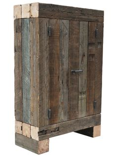 The cabinet looks like a pile of beams and has a geometric pattern, as opposed to the round trunk pattern. An interior cupboard is slid into an exterior cupboard, and the sides of plywood are covered by solid wood. In this way, the fixtures of the blocks of wood are kept out of sight, and the end grain of the plywood is finished. The measurements, the solution for the skirting, and the way the handle is concealed in the surface of the end grain timber, all these result from features of the…