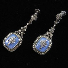 Sterling Silver German Art Deco Chalcedony and Marcasite Earrings. The earring is hinged in two places - below the ear mount and above the chalcedony - so that it moves and sways. The chalcedony is tranlucent and in an open-backed bezel setting so that light passes through it to reveal a beautiful blue-grey color with a slight violet cast.