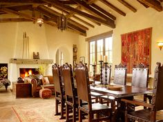Vaulted great room with ceiling beams, stucco fireplace, rust wall hanging & burnt orange rug  -- Miller Architects, ctmarchitects.com -- North Star Ranch, Colorado -- #NorthStarRanch