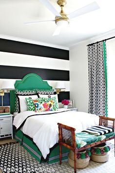ONE ROOM CHALLENGE- TEEN GIRL'S BEDROOM REVEAL || Black, White, Kelly Green Bedroom || Dimples and Tangles || green upholstered headboard, black and white striped wall, black and white curtains, wall sconces, black crosses rug, pom pom baskets, bamboo bench