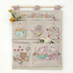 This would be a great for sewing room wall. Just change the embroidery to sewing!