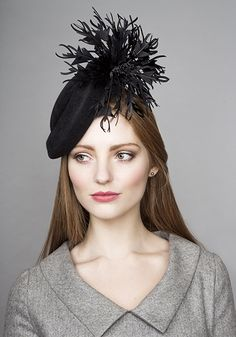 R15W28 - Black button hat with feather flower trim