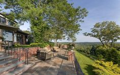 The two-level terrace at this Bedford, NY home spotlights sweeping views from New Jersey through to Connecticut.