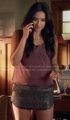 773cb4d6ecc72 Emily s red striped tank top and studded leather mini skirt on Pretty  Little Liars. Outfit