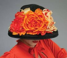 Louise Green Blaze Roses Bonnet      From the legendary milliner, a fiery array of profusely petaled blooms flatter a classic black felt lampshade hat that alludes to beautiful eyes. Arrives in a keepsake hatbox. USA