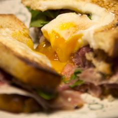 Toad In The Hole Sandwich: simple grilled cheese sandwich between two eggs-in-a-hole.