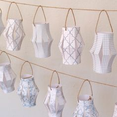 Paper lanterns.. Use thicker paper and add some water color! So cool!