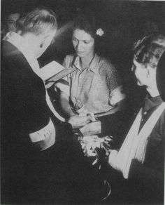 Warsaw Uprising 1944. This wedding took place during the second week of the Uprising. She is Aiicja Treutler, paramedic. He is Bolesław Biega, lieutenant. The priest's name is Wiktor Potrzebski.