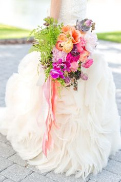 Colorful, whimsical bouquet: http://www.stylemepretty.com/florida-weddings/winter-park-fl/2015/08/12/bright-whimsical-winter-park-wedding/ | Photography: Amalie Orrange - http://amalieorrangephotography.com/