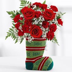 You won't find coal in your stocking this year–just beautiful, blooming flowers! This keepsake knit stocking is overflowing with red roses, mini carnations, baby's breath and greens to make the cutest gift or decoration.