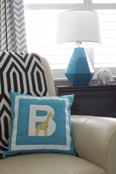 Modern Accents in this Aqua and Gray Zoo Themed Nursery