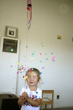 DIY Confetti Poppers - kids pull on a string to release the confetti on New Year's Eve