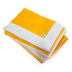 Yellow bath towel with contrasting white borders, made of soft, prestige fabric that's velvety to the touch.