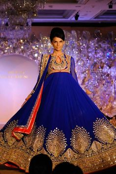 Peacock motifs appeared in zardozi, gota tukdi and mirror work. Anarkali by Abu Jani-Sandeep Khosla