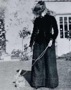 Beatrix Potter and pet rabbit on a leash