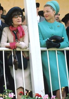 I think this is the only non B&W picture I've ever see if her. And she is in PINK!! Coco Chanel at The Grand Prix Of Diane 1964.