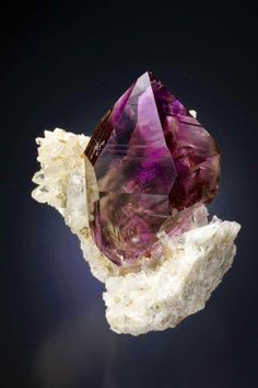 rare Amethyst Point sitting atop a quartz crystal matrix  (Photo Credit: Y Okazaki)
