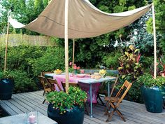 Create your own shade with PVC poles, flower pots and a painters drop cloth!