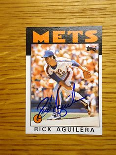 Rick Aguilera: (1985-1989 New York Mets) 1986 Topps baseball card signed in blue sharpie. (From my All-Time Mets Roster collection.)