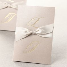 Simple and Classy Initials II (BH1026) is simple yet classy ecru invitation that showcases the bride and groom by displaying the couple's initials in shimmering gold scrips. It starts from $1.99 per invitation!