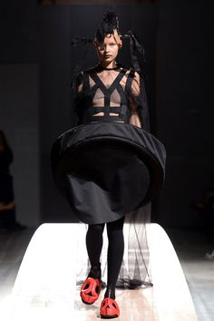black dress with 3D circular structure & exaggerated silhouette - shape & volume; Comme des Garçons 2014
