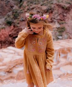 Long-sleeved dress in thick cotton decorated with delicate flowered embroideries and sequins. The motifs and colors echo traditional Peruvian weaves. The ties can by knotted in front or on the side. Available in size 3 months to 14 years old Peruvian Weave, 14 Year Old, Kids Fashion, Folk, Weaving, Fall Winter, Delicate, Sequins, Hipster