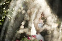 Blush bouquet  |  Military weddings  |  Marines  |  Hand-tied bouquet  |  Garden weddings  |  Fountains  |  Water photography  |  Backlighting  |  Creative photography  |  Pensacola weddings  |  Aislinn Kate Photography