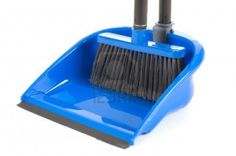 close-up of plastic broom with dustpan isolated on white