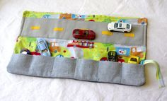 This is our favorite diaper bag toy, so nice for a quiet distraction in the waiting room or at church and I always know how many cars to look for when they're done playing. Pin now and explore later. Toys for boys, Toys for Toddlers, Diaper Bag Essentials, Car Wallet #HappinessbyRuth https://www.etsy.com/listing/223930771/diaper-bag-toy-car-carrier-play-mat?ref=shop_home_active_1 baby toys -