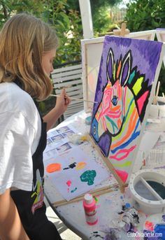 Social artworking zebra paintings from tween girls - takes all of the guesswork out of a fun painting art party!