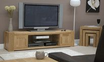 """If you are looking for a wide unit to house a large TV and many other appliances, then Trend Solid Oak Large Plasma TV Unit could be the one for you. Contemporary in style with """"chunky"""" solid oak features. Buy this light oak furniture in store or online. Solid Oak Furniture, Furniture Sets, Plasma Tv Stands, Oak Furniture Superstore, Television Cabinet, Large Tv Stands, Floating Glass Shelves, Oak Sideboard, Shower Shelves"""