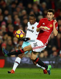 Matteo Darmian of Manchester United attempts to block Diafra Sakho of West Ham United cross during the Premier League match between Manchester United...
