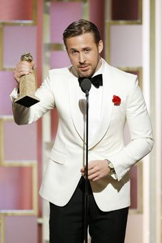 Ryan Gosling accepts the award for Best Actor in a Motion Picture - Musical or Comedy for his role in 'La La Land' during the 74th Annual Golden Globe Awards.