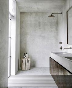 No shower screen on this one. Concrete, wood minimal bathroom design