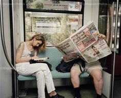Martin Parr reading on the train, 2002