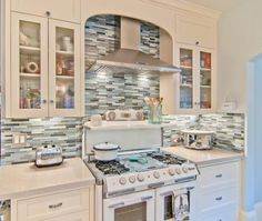 Pass on the curved section in front of the  range hood ----Eclectic Galley Style Light Blue kitchen, white cabinets, Struthers Dias Architects, San Francisco Bay Area